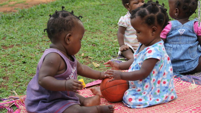 Children play at Amani Baby Cottage, an orphanage in Uganda.