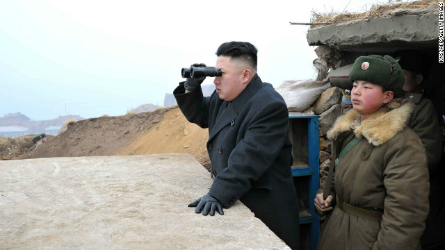 Kim uses a pair of binoculars to look south from the Jangjae Islet Defense Detachment near South Korea's Taeyonphyong Island on March 7.