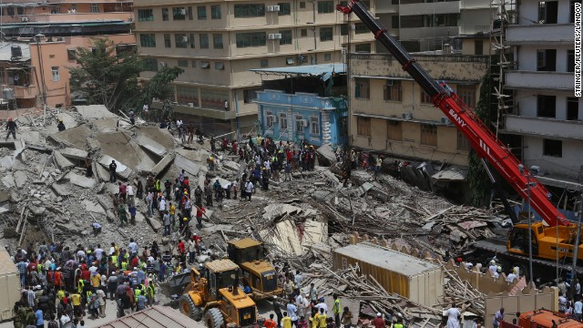 Rescue workers search for survivors as bystanders watch, after a building under construction in the Kariakoo district of central Dar es Salaam, Tanzania, collapsed on March 29.