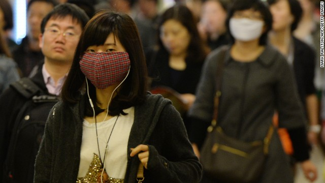 Pedestrians in Shanghai wear face masks to protect themselves from the H7N9 bird flu virus on Tuesday, April 16. At least 60 people have been infected and 13 have died in the past two weeks from the disease, according to Xinhua news agency.