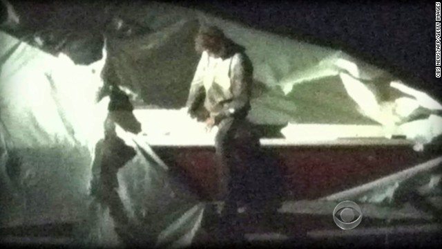 Dzhokhar Tsarnaev gets out of the boat he was hiding in outside of a home in Watertown, as seen in a surveillance video still.