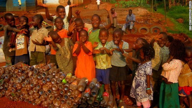 Using thousands of waste bottles, the talented artist turned a school yard in Kampala's Kireka community into a fun and safe place where children can play and learn.