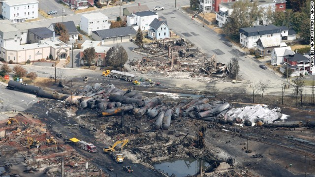 Burned tanker cars are scattered on the tracks in Lac-Megantic, Quebec, on Monday, July 8. On Saturday, July 6, the train, pulling tankers of crude oil, rolled into the town unattended from 7 miles away, derailed and exploded.
