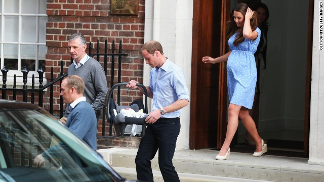 The new parents leave the hospital Tuesday evening with William carrying the boy out in a car seat and installing him in the back of a black SUV for the trip to Kensington Palace.