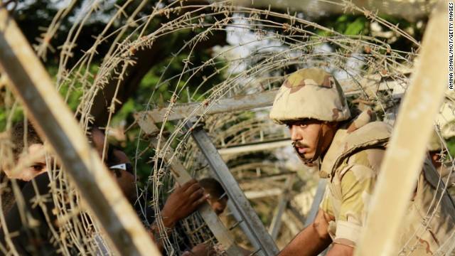 A soldier sets up barbed wire in anticipation of protesters outside the constitutional court in Cairo on Sunday, August 18. The protesters never showed up. Over the past week, about 900 people -- security forces as well as citizens -- have been killed. Deaths occurred when the military used force to clear supporters of ousted President Mohamed Morsy from two sit-in sites in Cairo on Wednesday, and violence raged after Morsy supporters staged demonstrations Friday. <a href='http://www.cnn.com/2013/07/04/middleeast/gallery/egypt-after-coup/index.html' target='_blank'>Look back at Egypt's unrest.</a>