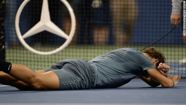 Spain's Rafael Nadal collapses to the ground after winning his second U.S. Open title, September 9, 2013.