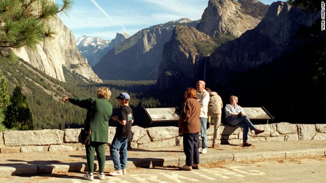 Tourists view Yosemite National Park in California after it re-opened on January 6, 1996. Early that morning, President Clinton signed Republican-crafted legislation to restore jobs and provide retroactive pay to government workers while he and Congress continued negotiating how to balance the federal budget.