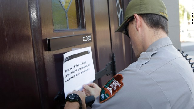 A National Parks Service ranger posts a sign on the doors of the historic Ebenezer Baptist Church in Atlanta on October 1 notifying visitors that the church is closed.