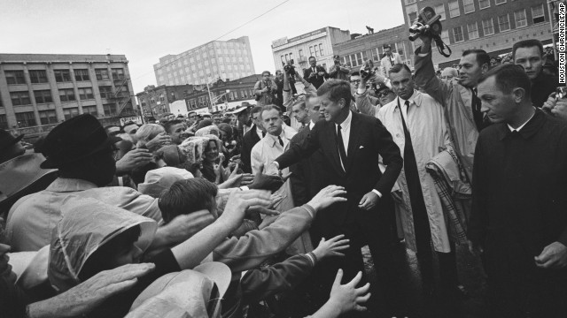 President John F. Kennedy greets supporters during his visit to Fort Worth, Texas, on Friday, November 22, 1963. This month marks 50 years since his assassination in Dallas, an event that jarred the nation and fueled a multitude of conspiracy theories about whether Kennedy was killed by a single gunman acting alone in the Texas School Book Depository. Here are some images from that fateful day as it unfolded.