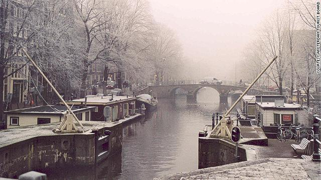 """""""The Dam"""" in winter months is relatively tourist free, making museums like the Rijksmuseum and Anne Frank House a peaceful and educational escape from the cold."""