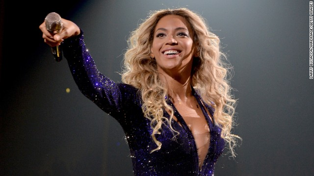 """Beyonce performs on stage during """"The Mrs. Carter Show World Tour"""" at Staples Center on December 3, in Los Angeles. She surprised fans by dropping her fifth LP, entitled """"Beyonce,"""" exclusively on iTunes with no advance notice. Here is a look back at her life and career:"""