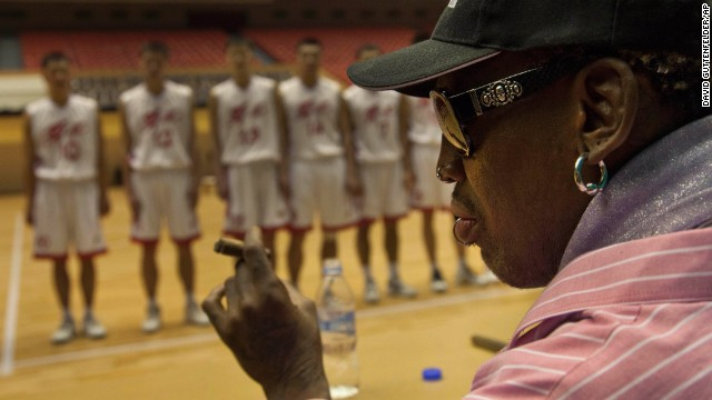 Rodman holds a cigar as he speaks to North Korean basketball players during a practice session in Pyongyang, North Korea, on December 20.