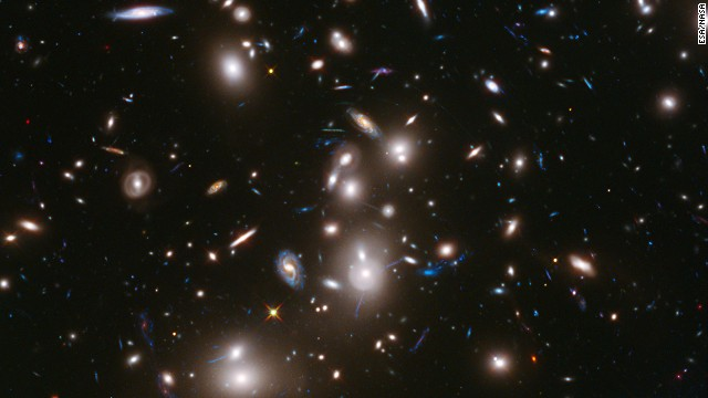 This long-exposure image from the Hubble Telescope is the <a href='http://hubblesite.org/newscenter/archive/releases/2014/01/full/' target='_blank'>deepest-ever picture taken of a cluster of galaxies. The cluster, </a>called Abell 2744, contains several hundred galaxies as they looked 3.5 billion years ago; the more distant galaxies appear as they did more than 12 billion years ago, not long after the Big Bang.<!-- --> </br>