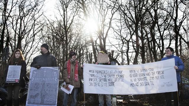 Protestors demonstrate outside the Copenhagen Zoo against the killing of the giraffe on February 9.