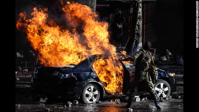 Protesters burn a car in central Kiev on February 18.