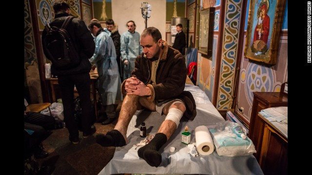 An injured protester waits to be treated in a Kiev monastery, converted into a makeshift hospital, on February 19.