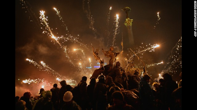 Fireworks explode over protesters in Independence Square on February 19.