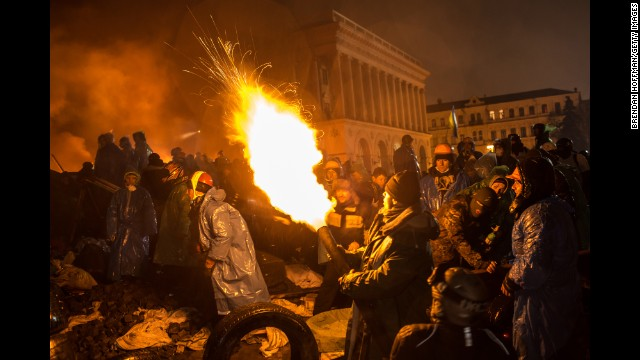 Protesters use a compressed air cannon to launch a Molotov cocktail toward police lines in Independence Square on February 19.