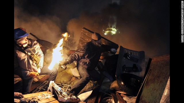 A protester hurls a Molotov cocktail toward police on February 19.