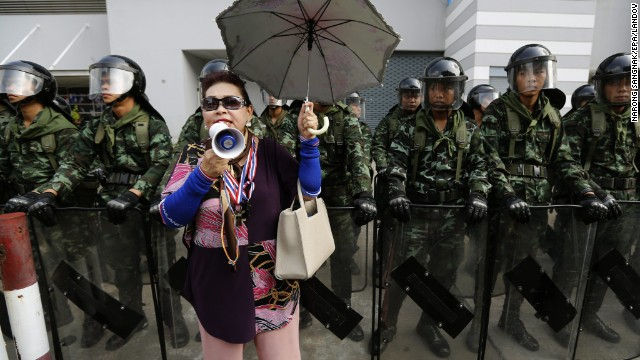 A protester shouts slogans in front of Thai army soldiers on guard during a rally in front of the temporary office of Prime Minister Yingluck Shinawatra at the defense ministry complex in Bangkok on Wednesday, February 19. Protesters have been calling for months for the ouster of Shinawatra, who they allege is a puppet of her billionaire brother, the deposed, exiled former Prime Minister Thaksin Shinawatra.