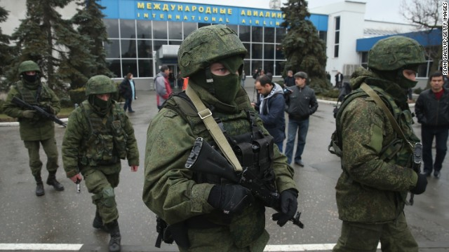 "Armed men patrol outside the Simferopol International Airport in Ukraine's Crimea region on Friday, February 28. The gunmen, whom Ukrainian Interior Minister Arsen Avakov called part of an ""armed invasion"" by Russian forces, appeared around the airport without identifying themselves. Crimea is an autonomous republic of Ukraine with an ethnic Russian majority. It's the last large bastion of opposition to Ukraine's new political leadership after President Viktor Yanukovych's ouster."