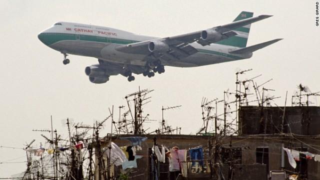 Planes landing at Hong Kong's nearby airport, Kai Tak, often roared overhead.