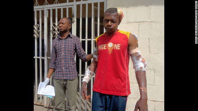 A paramedic helps a young man as he leaves a hospital in the northern Nigerian city of Kano on January 21, 2012. A spate of bombings and shootings left more than 200 people dead in Nigeria's second-largest city. Three days later, a joint military task force in Nigeria <a href='http://www.cnn.com/2012/01/24/world/africa/nigeria-attacks/'>arrested 158 suspected members</a> of Boko Haram.