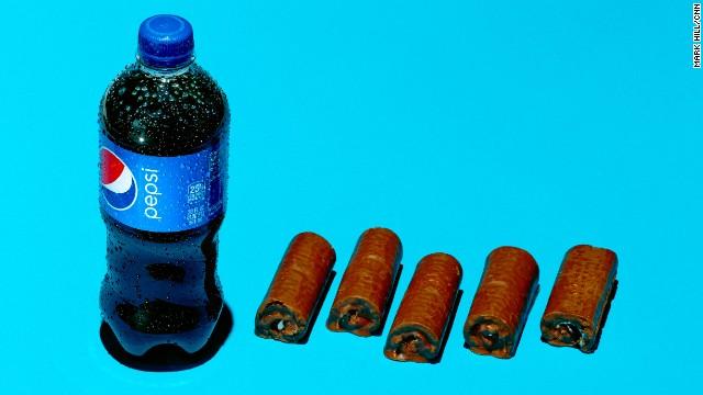 <strong>Soda: Pepsi.</strong><!-- --> </br>A 20-ounce bottle of Pepsi contains 69 grams of sugar. Each Little Debbie Swiss Roll contains an estimated 13 grams of sugar.