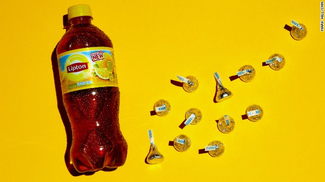 <strong>Tea: Lipton Lemon Iced Tea.</strong><!-- --> </br>There are 32 grams of sugar in this 20-ounce bottle of iced tea. Each of these 12 Hershey's Kisses contains approximately 2.5 grams of sugar.