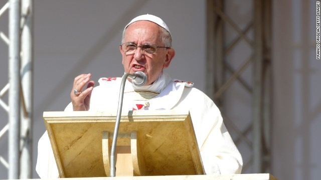 """Pope Francis speaks during the feast-day Mass on a one-day trip to the Calabrian region of Italy on Saturday, June 21. The Pope spoke out against the Mafia's """"adoration of evil and contempt for the common good,"""" and declared that """"mafiosi are excommunicated, not in communion with God.'"""