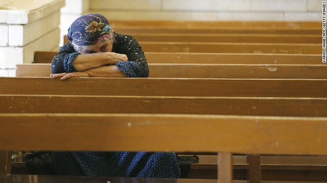 An Iraqi Christian prays at the Saint George church on July 1 in Erbil
