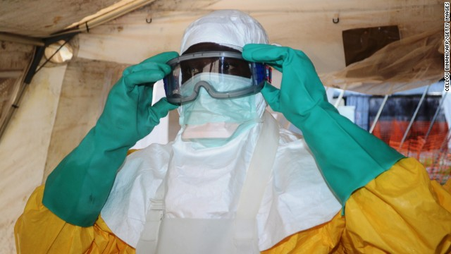 A member of Doctors Without Borders puts on protective gear at the isolation ward of the Donka Hospital in Conakry on Saturday, June 28.