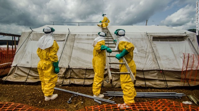 Members of Doctors Without Borders adjust tents in the isolation area in Kailahun on July 20.