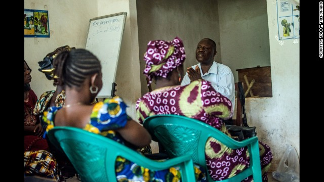 Dr. Mohamed Vandi of the Kenema Government Hospital trains community volunteers who will aim to educate people about Ebola in Sierra Leone.