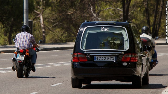 A hearse carries the coffin of Spanish priest Miguel Pajares after he died at a Madrid hospital on Tuesday, August 12. Pajares, 75, contracted Ebola while he was working as a missionary in Liberia.
