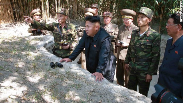 "North Korean leader Kim Jong-un, center, tours a frontline military unit, in this image released July 16 by state run North Korean Central News Agency. A recent <a href='http://www.cnn.com/2014/02/17/world/asia/north-korea-un-report/index.html'>United Nations report</a> described a brutal North Korean state ""that does not have any parallel in the contemporary world."""