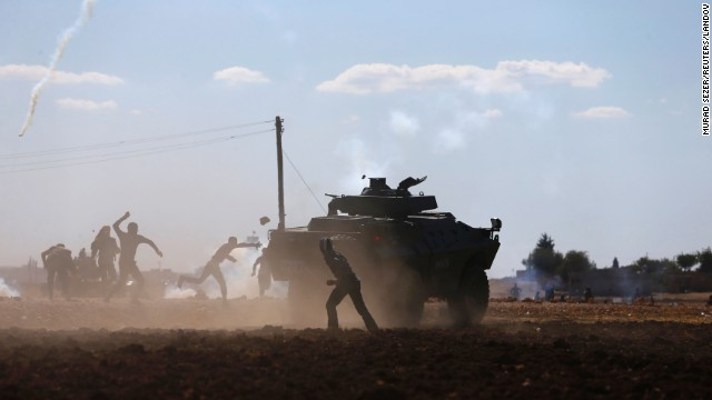 Turkish Kurds clash with Turkish security forces during a protest near Suruc on Monday, September 22. According to Time magazine, the protests were over Turkey's temporary decision to close the border with Syria.