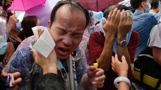 Police use pepper spray and tear gas against demonstrators September 28. The protests, which have seen thousands of students in their teens and 20s take to the streets, swelled in size over the weekend.