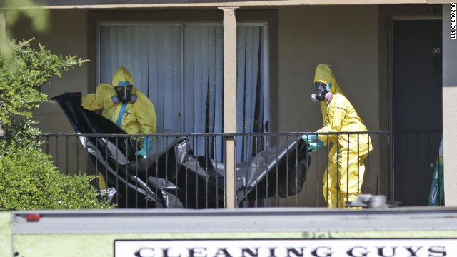 A hazardous materials team cleans the Dallas apartment where four contacts of Ebola patient Thomas Eric Duncan are under quarantine on Friday, October 3. Duncan, the first person diagnosed with Ebola on American soil, contracted the virus in his home country of Liberia.