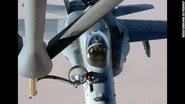 In this photo released by the U.S. Air Force on Saturday, October 4, a U.S. Navy jet is refueled in Iraqi airspace after conducting an airstrike against ISIS militants.