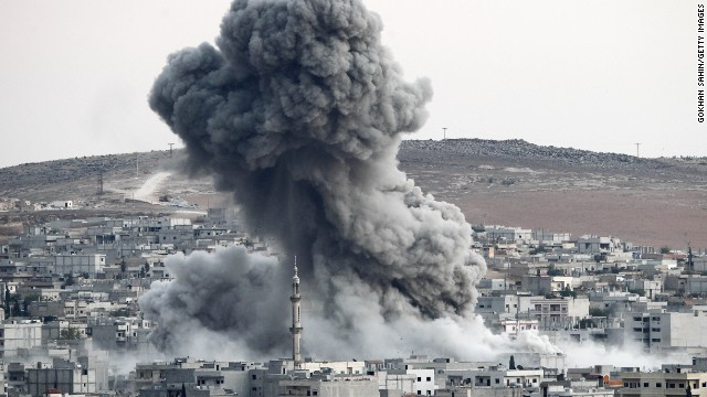 Heavy smoke rises in Kobani following an airstrike by the U.S.-led coalition on Saturday, October 18.