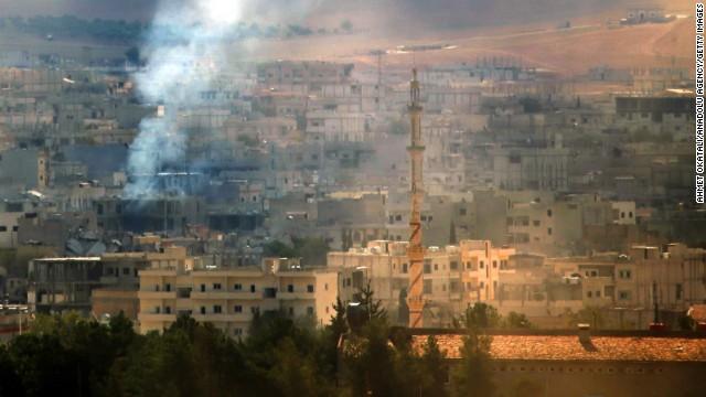 Smoke rises during fighting in Kobani on Monday, October 27.