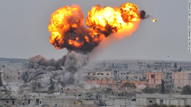 Fire and smoke rise from Kobani following airstrikes against ISIS on Thursday, October 30.