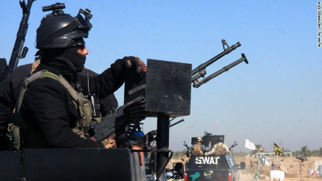 Iraqi military forces take up position in Jurf al-Sakhar, Iraq, on November 8.