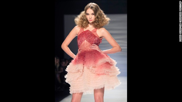 """Pantone, the company that considers itself the authority on colors in consumer trends, announced in December that marsala was its pick for 2015's color of the year. Pantone called it """"a naturally robust and earthy wine red,"""" that's """"subtly seductive."""" Here, a model walks the runway in marsala during the Mikael D show at Fashion Week in Toronto."""