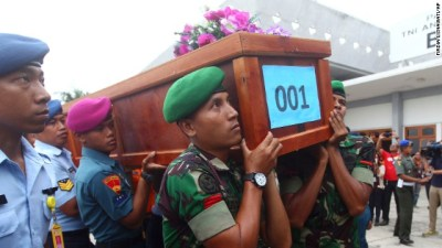 Indonesian soldiers carry a coffin containing a victim of AirAsia Flight QZ8501 upon arrival at an air force base in Surabaya, Indonesia, on Wednesday, December 31. Indonesia's national search and rescue agency confirmed that the debris found is from that flight, the airline said Tuesday.