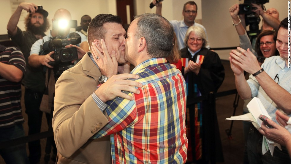 Chad Biggs, left, and his fiance, Chris Creech, say their wedding vows at the Wake County Courthouse in Raleigh, North Carolina, on Friday, October 10, after a federal judge ruled that same-sex marriage can begin there.
