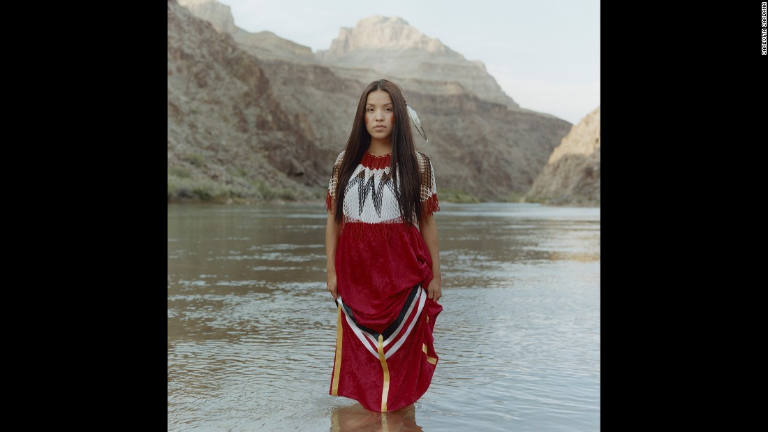 "Sage Honda, a 22-year-old from Peach Springs, Arizona, wears a handmade dress at the Grand Canyon, a sacred site of the Hualapai people. Since appearing in Miss Native American USA, she has been encouraging Native youth to travel off the reservation to explore more opportunities. ""I want to be a role model to show my community and youth that it is possible to come off our land and do big things,"" she said in the ""Red Road"" photo series."