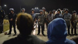 Calls for calm in Ferguson after shooting