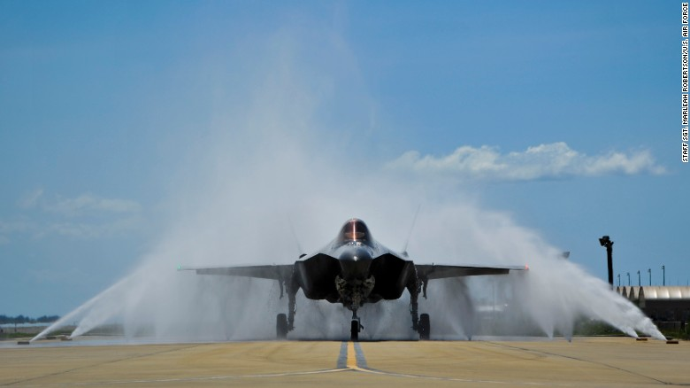 """Lt. Col. Christine Mau navigates her F-35A through the """"bird bath"""" after returning from her first flight on Eglin Air Force Base, Florida, on Tuesday."""